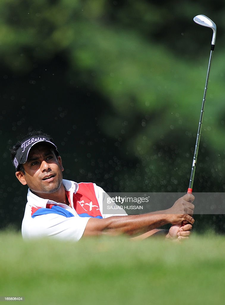 Shakhawat Sohel of Bangladesh plays a shot during the Panasonic Open India at the Delhi Golf Club in New Delhi on April 6, 2013. The 300 000 US dollar tournament is being played from April 4-7. AFP PHOTO / SAJJAD HUSSAIN