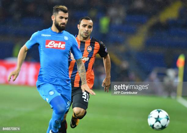 Shakhtar Donetsk's Brazilian defender Ismaily and SSC Napoli's Albanian defender Elseid Hysaj vie for the ball during the UEFA Champions League Group...