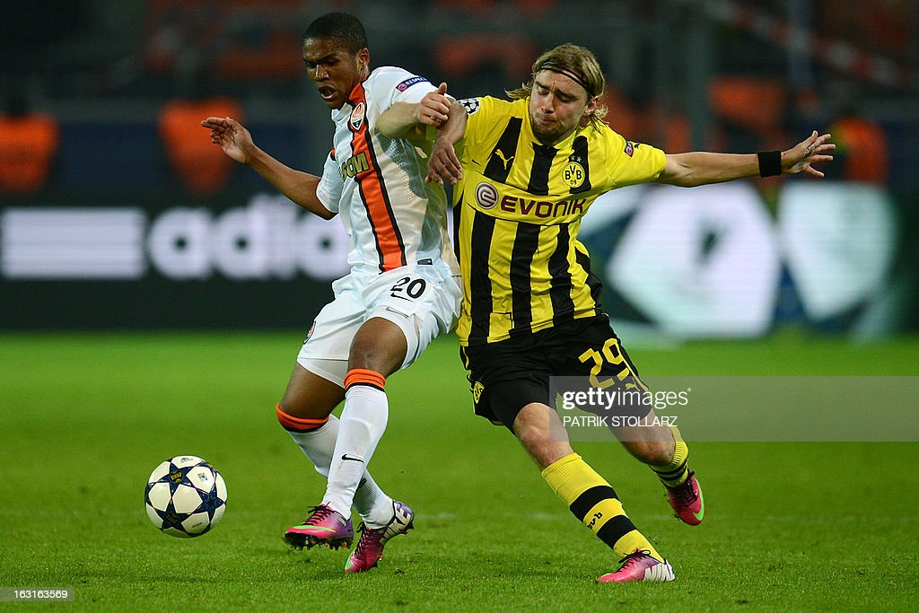 Shakhtar Donetsk's Brazilian midfielder Douglas Costa (L) vies with Dortmund's defender Marcel Schmelzer during the UEFA Champions League last 16, second leg match Borussia Dortmund vs Shakhtar Donetsk in Dortmund, western Germany, on March 5, 2013.
