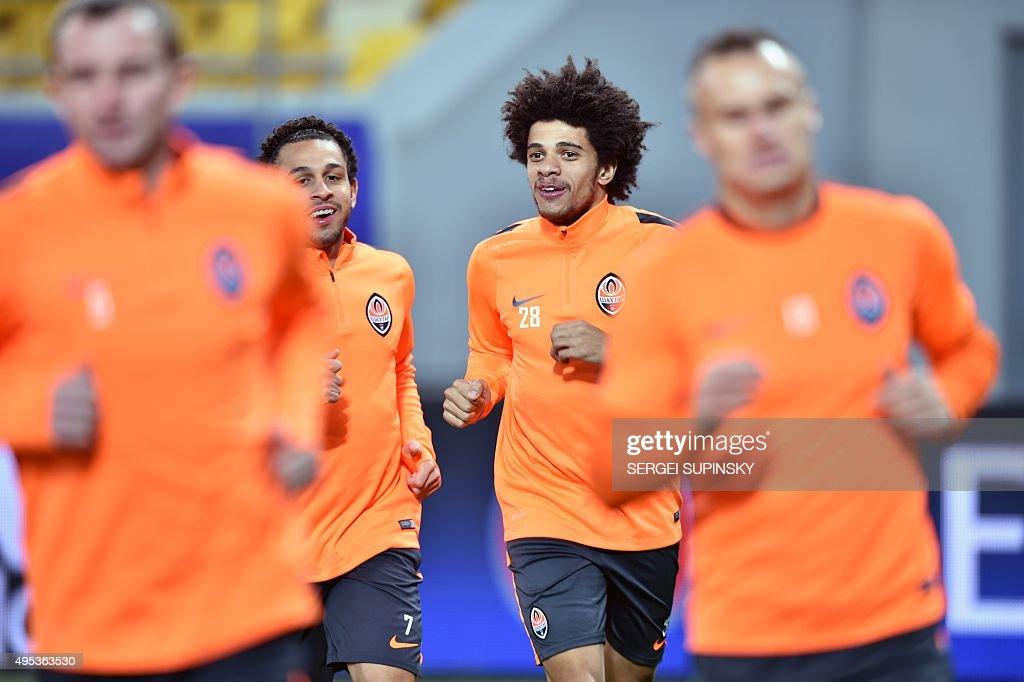 Shakhtar Donetsk's Brazilian players Taison and Wellington Nem take part in a training session at Arena Lviv Stadium in Lviv on November 2 2015 day...