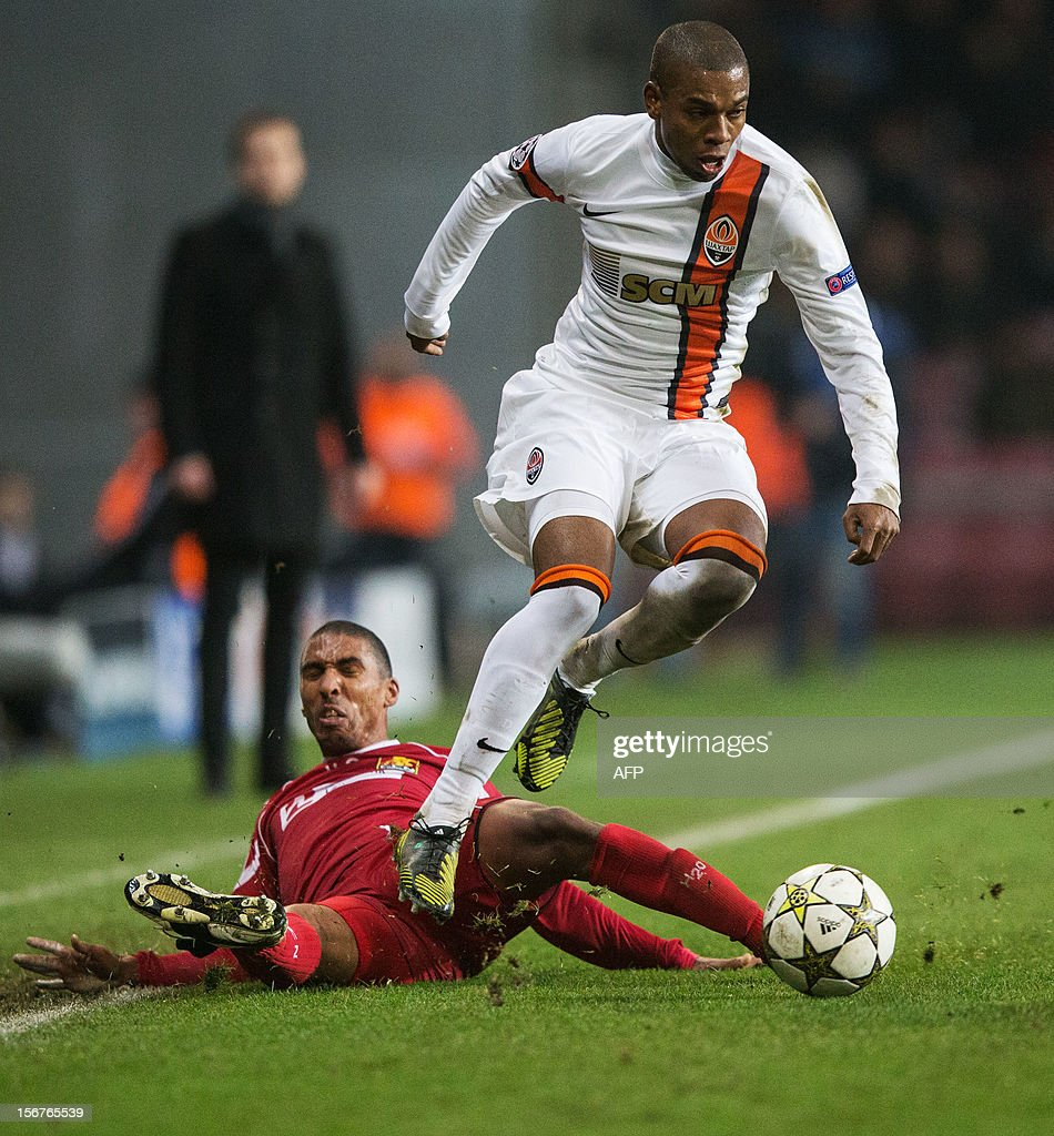 Shakhtar Donetsk s Brazilian striker Luiz Adriano top jumps over