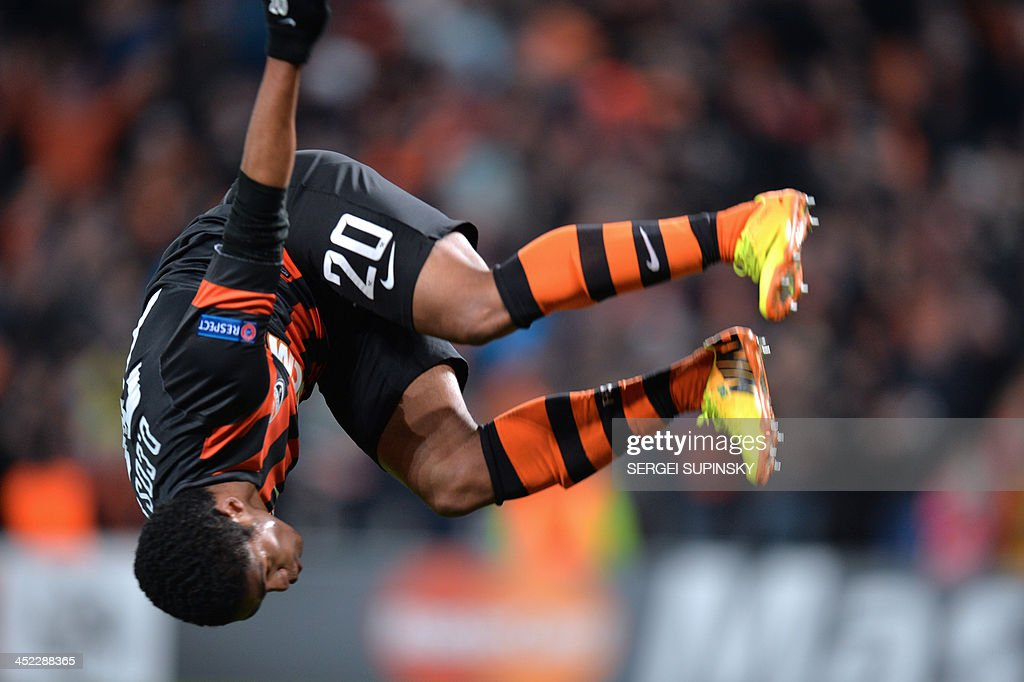 FC Shakhtar Donetsk's Douglas Costa celebrates after he scored against Real Sociedad during their UEFA Champions League Group A football match in Donetsk on November 27, 2013.