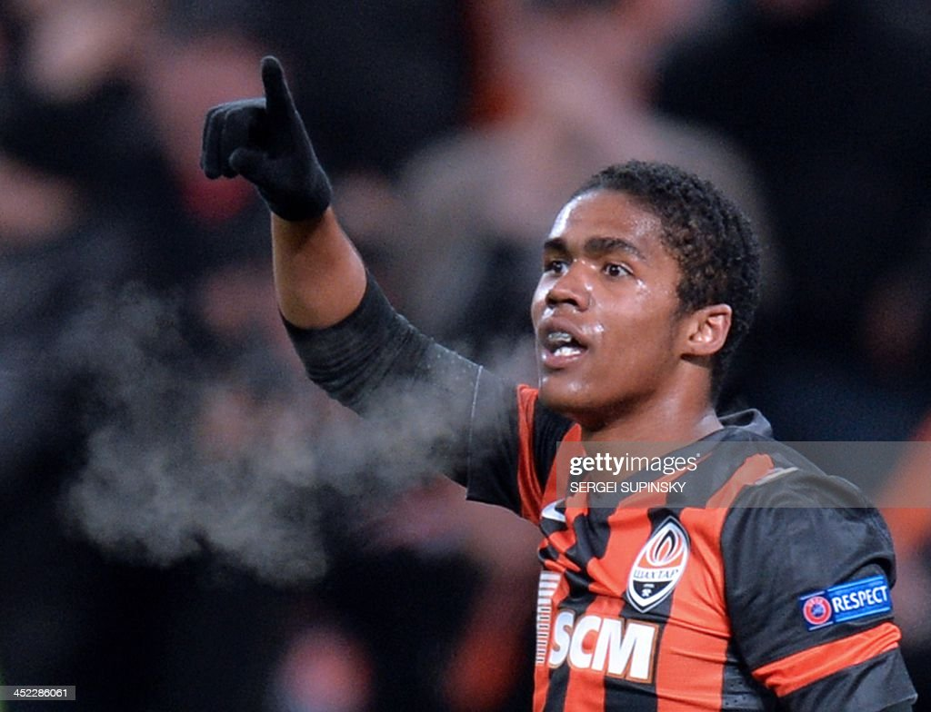 FC Shakhtar Donetsk's Douglas Costa celebrates scoring against Real Sociedad during their UEFA Champions League Group A football match in Donetsk on...