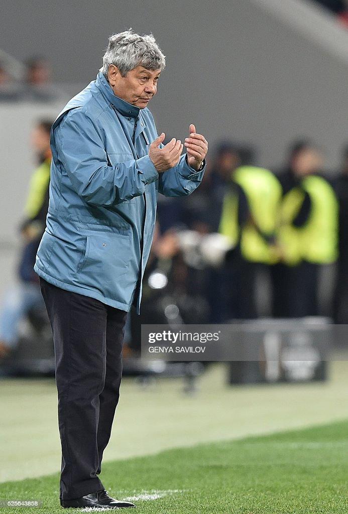 Shakhtar Donetsk's head coach Mircea Lucescu reacts during the UEFA Europa League semi-final football match FC Shakhtar Donetsk vs Sevilla FC at the Arena Lviv stadium in Lviv on April 28, 2016. / AFP / GENYA