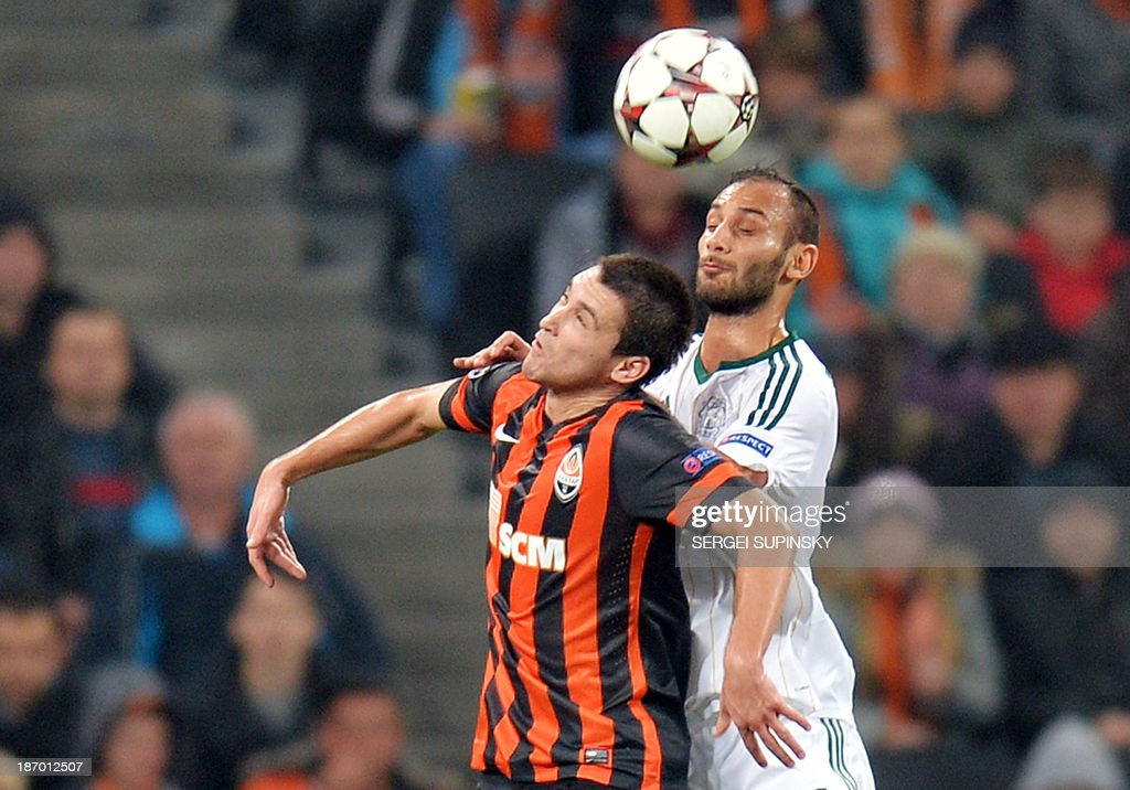 Shakhtar's Argentinian forward Facundo Ferreyra (L) jumps for the ball with Leverkusen's Turkish defender Omer Toprak during the UEFA Champions League Group A football match Shakhtar Donetsk vs Bayer Leverkusen in Donetsk on November 5, 2013.