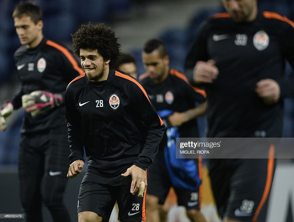 Shakhtar's Brazilian forward <a gi-track='captionPersonalityLinkClicked' href=/galleries/search?phrase=Taison&family=editorial&specificpeople=5613080 ng-click='$event.stopPropagation()'>Taison</a> (C) warms up during a training session at the Dragao Stadium in Porto, on December 9, 2014, on the eve of the UEFA Champions League football match against FC Porto.