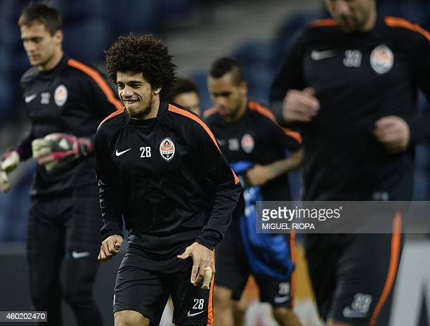 Shakhtar's Brazilian forward Taison warms up during a training session at the Dragao Stadium in Porto on December 9 on the eve of the UEFA Champions...