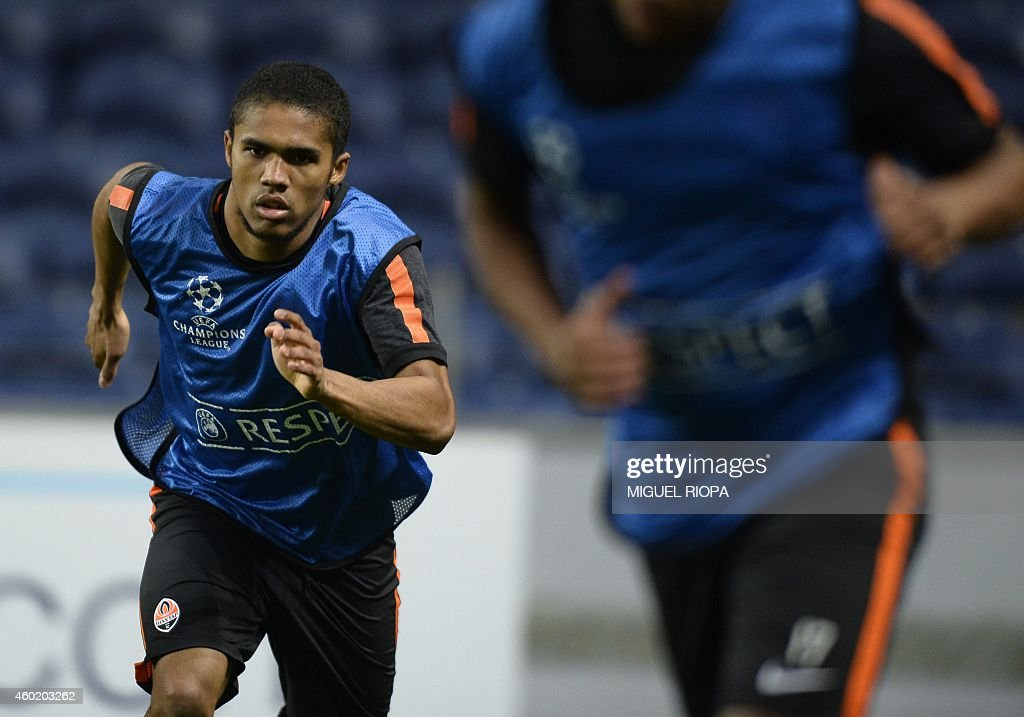 Shakhtar's Brazilian midfielder Douglas Costa takes part in a training session at the Dragao Stadium in Porto on December 9 on the eve of the UEFA...