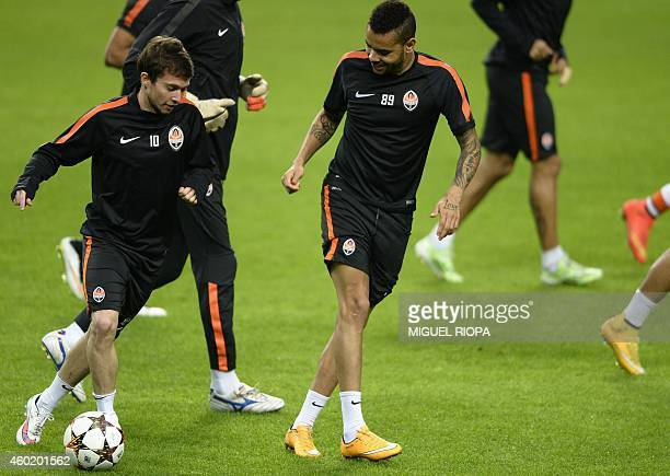 Shakhtar's Brazilian midfielders Bernard and Dentinho take part in a training session at the Dragao Stadium in Porto on December 9 on the eve of the...