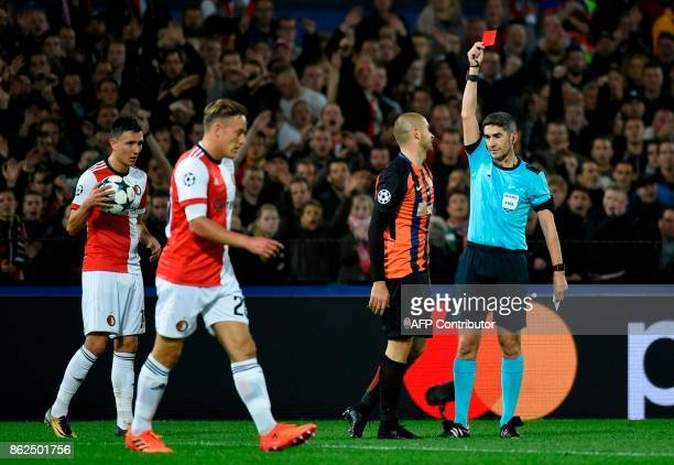 Shakhtar's defender Yaroslav Rakitskiy receives a red card by the referee during the UEFA European Champions League Group F football match between...