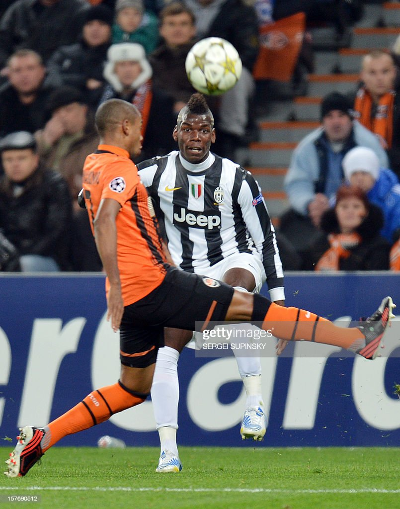 FC Shakhtar's Fernandinho (L) vies for the ball with Juventus' <a gi-track='captionPersonalityLinkClicked' href=/galleries/search?phrase=Paul+Pogba&family=editorial&specificpeople=5805302 ng-click='$event.stopPropagation()'>Paul Pogba</a> during the UEFA Champions League, Group E, football match between FC Shakhtar and Juventus, in Donetsk on December 5, 2012. Juventus won 1-0.