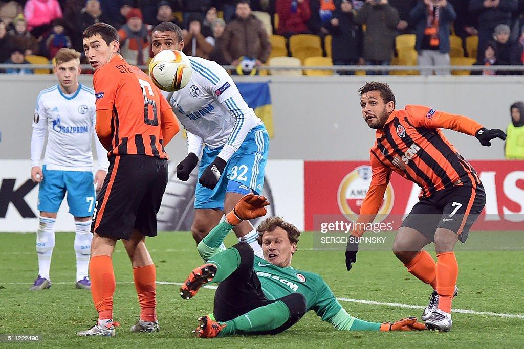 Shakhtar's goalkeeper Andriy Pyatov Shakhtar's Brazilian midfielder Wellington Nem and Shakhtar's midfielder Taras Stepanenko vie with Schalke's...