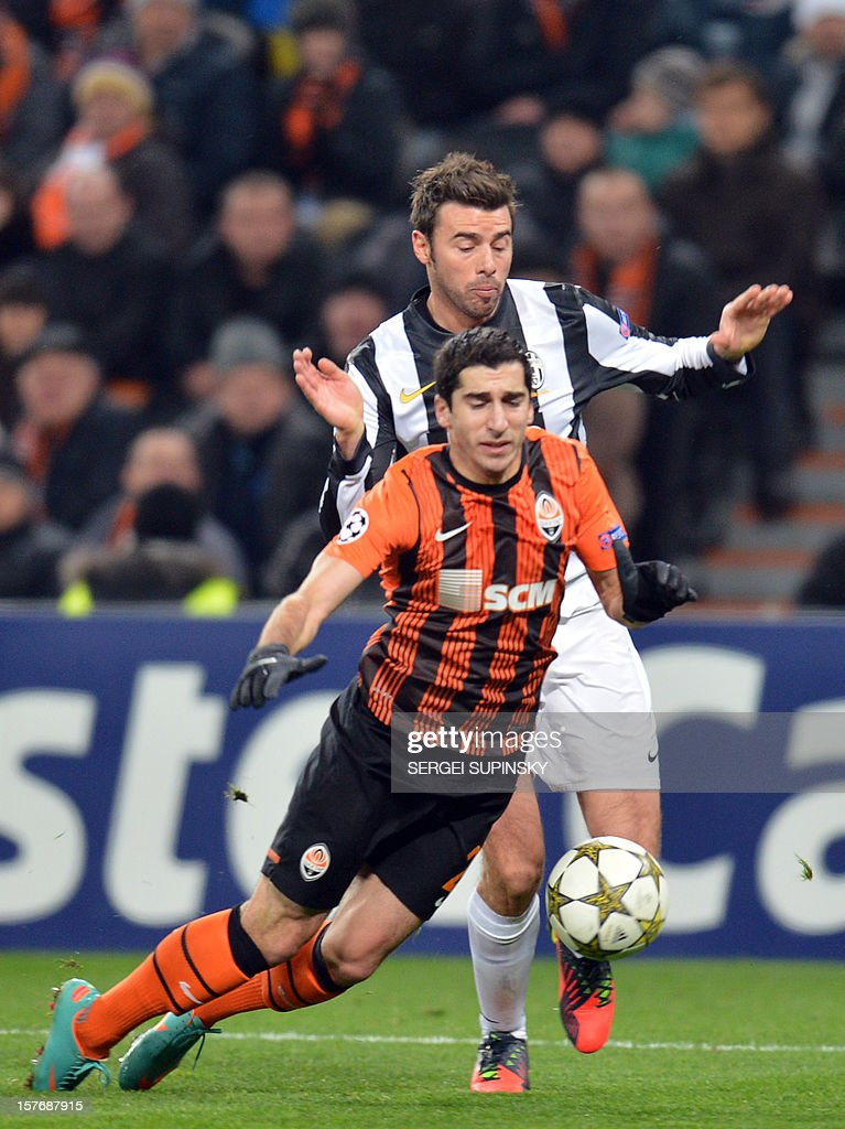 FC Shakhtar's Henrikh Mkhitaryan (Front) vies for the ball with Juventus' Andrea Barzagli during the UEFA Champions League, Group E, football match between FC Shakhtar and Juventus, in Donetsk on December 5, 2012.