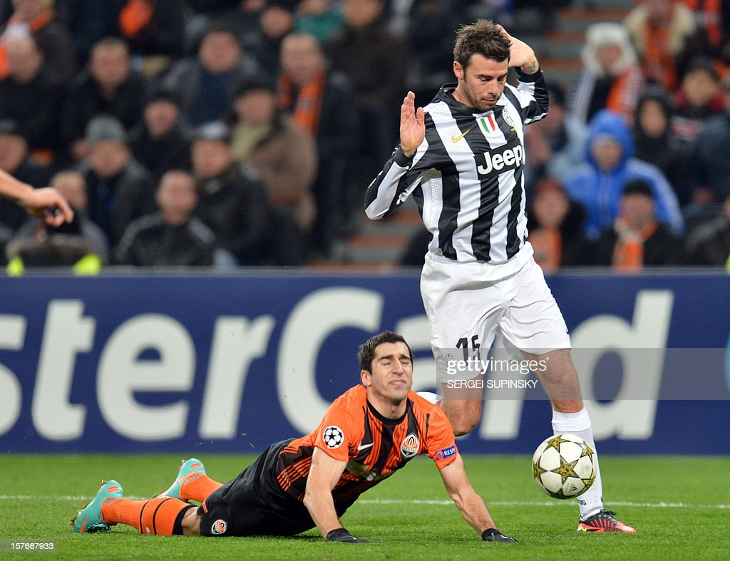 FC Shakhtar's Henrikh Mkhitaryan (L) vies for the ball with Juventus' Andrea Barzagli during the UEFA Champions League, Group E, football match between FC Shakhtar and Juventus, in Donetsk on December 5, 2012.