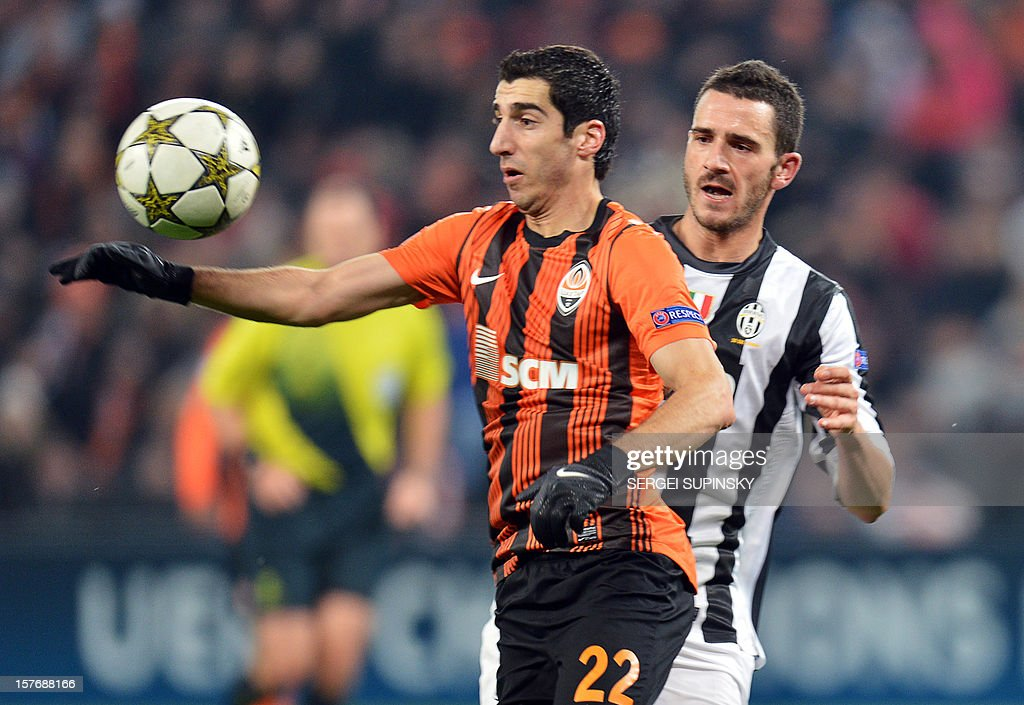 FC Shakhtar's Henrikh Mkhitaryan (L) vies for the ball with Juventus' Mirko Vucinic during the UEFA Champions League, Group E, football match between FC Shakhtar and Juventus, in Donetsk on December 5, 2012.