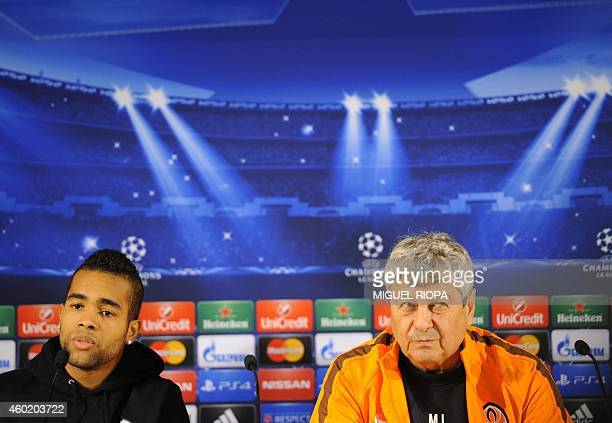 Shakhtar's Romanian coach Mircea Lucescu and Brazilian midfielder Alex Teixeira give a press conference at the Dragao Stadium in Porto on December 9...