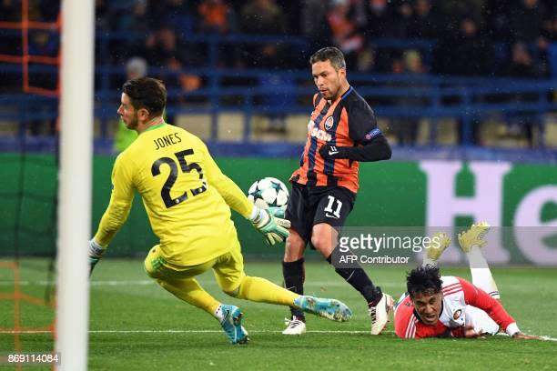 Shakhtar's Ukrainian midfielder Marlos shoots and scores a goal past Feyenoord's Australian goalkeeper Brad jones during the UEFA Champions League...
