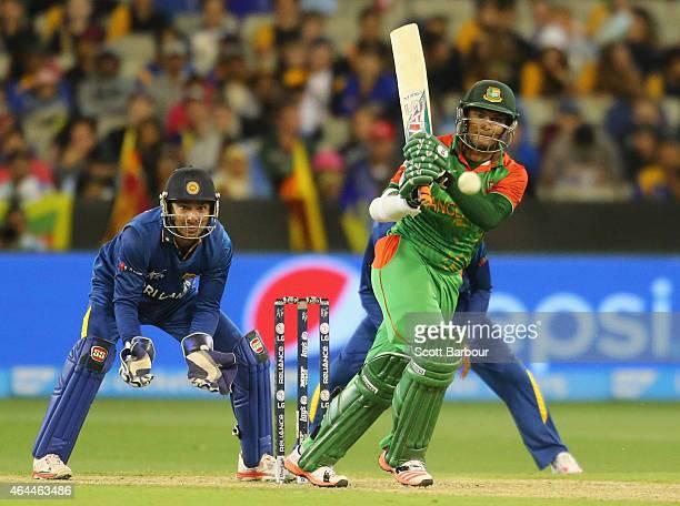Shakib Al Hasan of Bangladesh bats as wicketkeeper Kumar Sangakkara of Sri Lanka looks on during the 2015 ICC Cricket World Cup match between Sri...