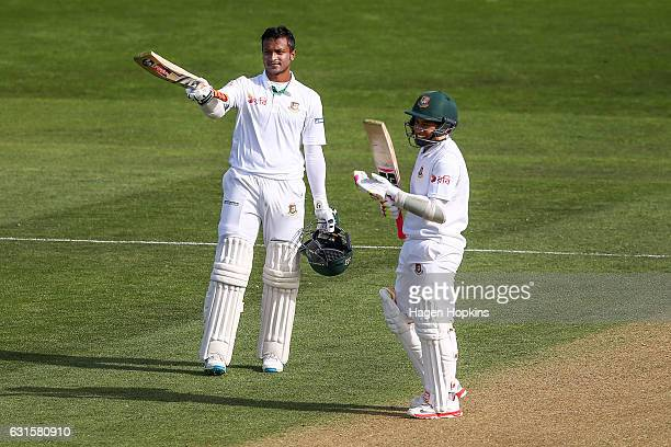 Shakib Al Hasan of Bangladesh celebrates his double century with teammate Mushfiqur Rahim during day two of the First Test match between New Zealand...