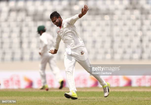 Shakib Al Hasan of Bangladesh celebrates taking the wicket of Glenn Maxwell of Australia during day four of the First Test match between Bangladesh...