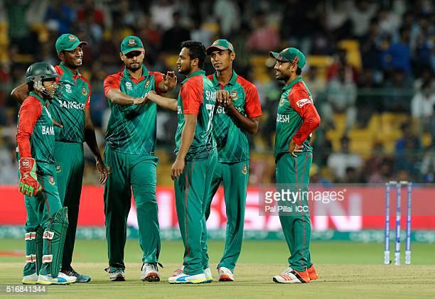 Shakib Al Hasan of Bangladesh celebrates the wicket of David Warner of Australia during the ICC World Twenty20 India 2016 match between Australia and...