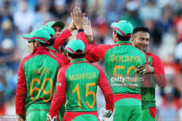 Shakib Al Hasan of Bangladesh celebrates with teammate Soumya Sarkar for the wicket of Brendon McCullum of New Zealand during the 2015 ICC Cricket...