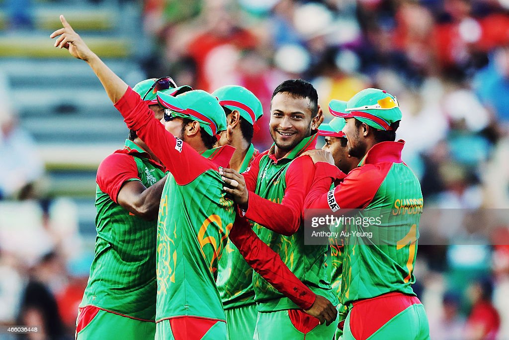 Shakib Al Hasan of Bangladesh celebrates with the team for the wicket of Kane Williamson of New Zealand during the 2015 ICC Cricket World Cup match...