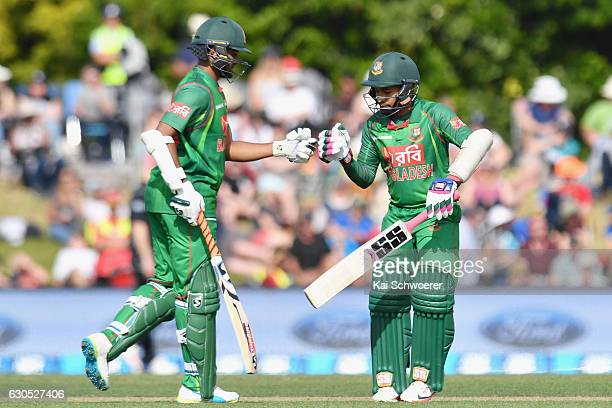 Shakib Al Hasan of Bangladesh is congratulated by Mushfiqur Rahim of Bangladesh after scoring his half century during the first One Day International...