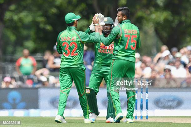 Shakib Al Hasan of Bangladesh is congratulated by team mates after dismissing Neil Broom of New Zealand during the first One Day International match...