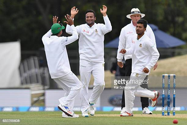 Shakib Al Hasan of Bangladesh is congratulated by team mates after dismissing Mitchell Santner of New Zealand during day two of the Second Test match...