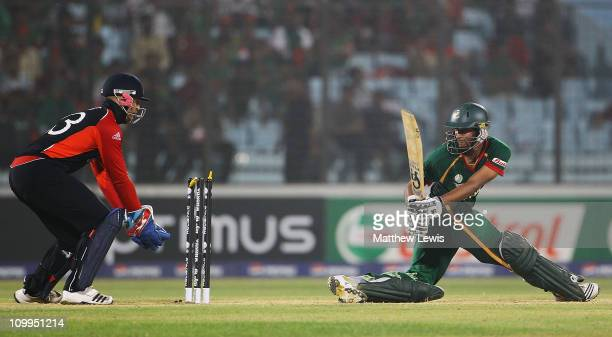 Shakib Al Hasan of Bangladesh looks on after he is bowled by Graeme Swann of England during the 2011 ICC World Cup Group B match between Bangladesh...