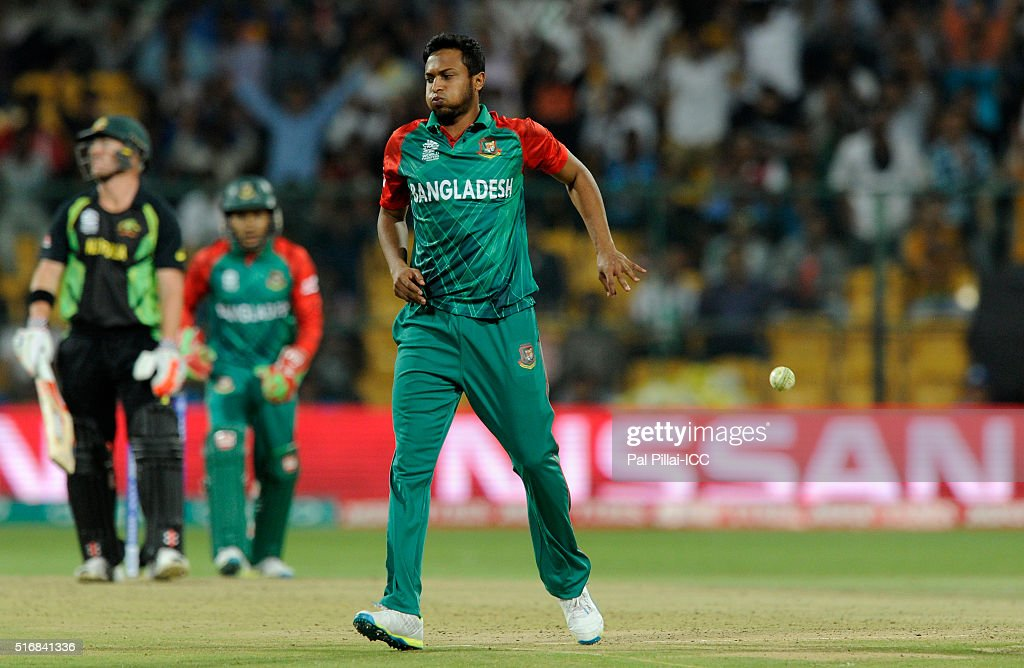 <a gi-track='captionPersonalityLinkClicked' href=/galleries/search?phrase=Shakib+Al+Hasan&family=editorial&specificpeople=4145971 ng-click='$event.stopPropagation()'>Shakib Al Hasan</a> of Bangladesh reacts after taking a return catch to get David Warner of Australia out during the ICC World Twenty20 India 2016 match between Australia and Bangladesh at the Chinnaswamy stadium on March 21, 2016 in Bangalore, India.