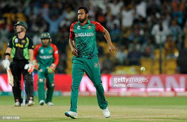 Shakib Al Hasan of Bangladesh reacts after taking a return catch to get David Warner of Australia out during the ICC World Twenty20 India 2016 match...