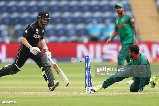 Shakib Al Hasan of Bangladesh runs out Kane Williamson of New Zealand during the ICC Champions Trophy match between New Zealand and Bangladesh at the...