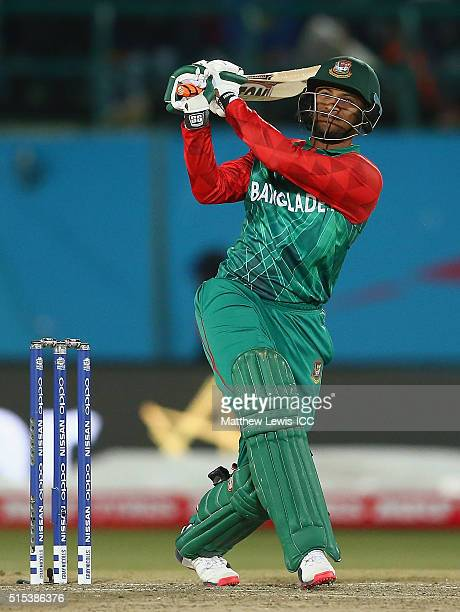 Shakib Al Hasan of Bangladeshhits the ball towards the boundary during the ICC World Twenty20 India 2016 match between Bangladesh and Oman at the...