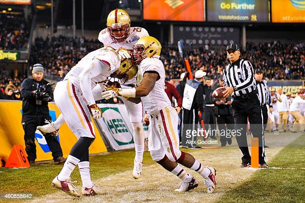 Shakim Phillips of the Boston College Eagles celebrates after scoring a touchdown with teammates David Dudeck and Sherman Alston in the third quarter...