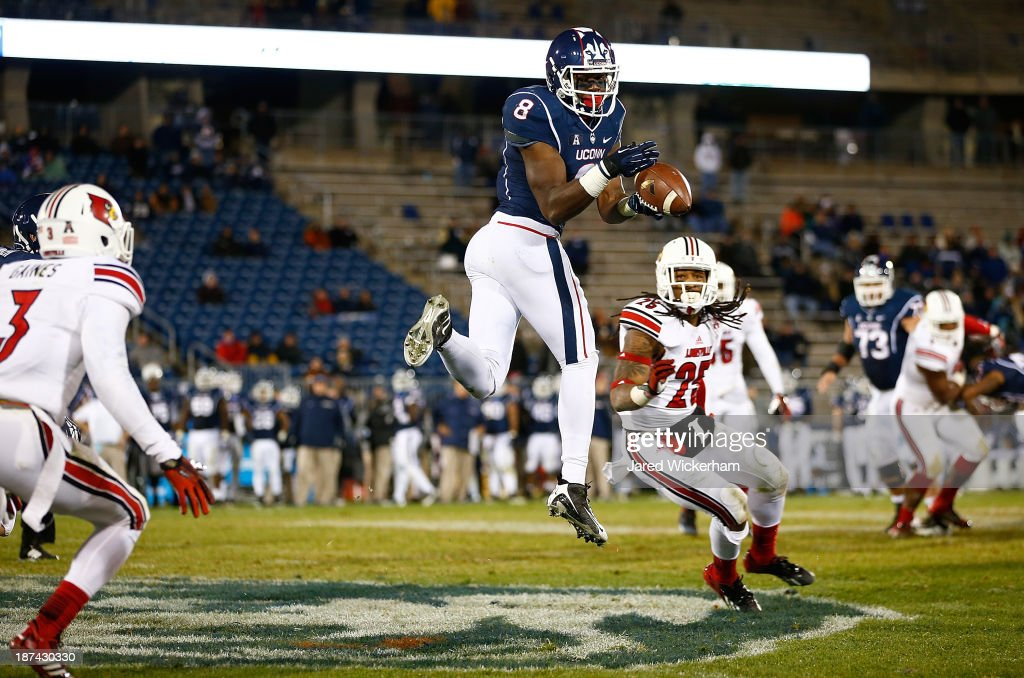 Shakim Phillips of the Connecticut Huskies makes a catch in the fourth quarter in front of Calvin Pryor of the Louisville Cardinals at Rentschler...