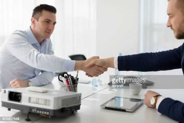 Shaking hands in office