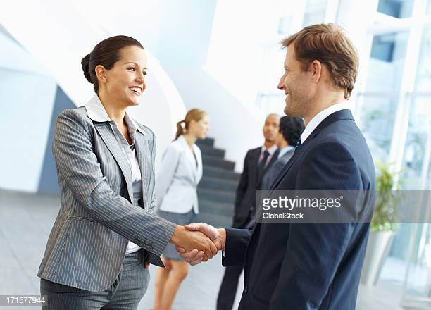 Shaking hands to their success
