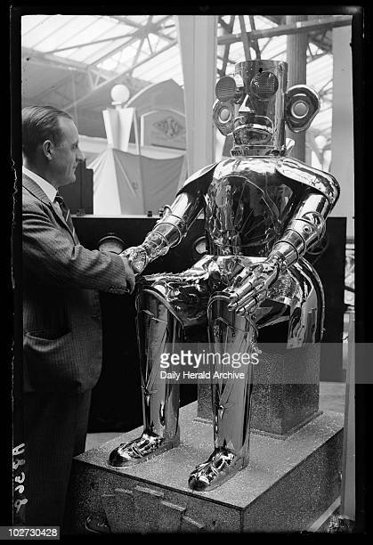 Shaking hands with 'The Monster Robot' 1932 A photograph of a man shaking hands with 'The Monster Robot' being exhibited by Mullard at the Radio...