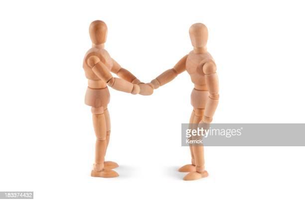 Shaking hands - wooden mannequin meeting