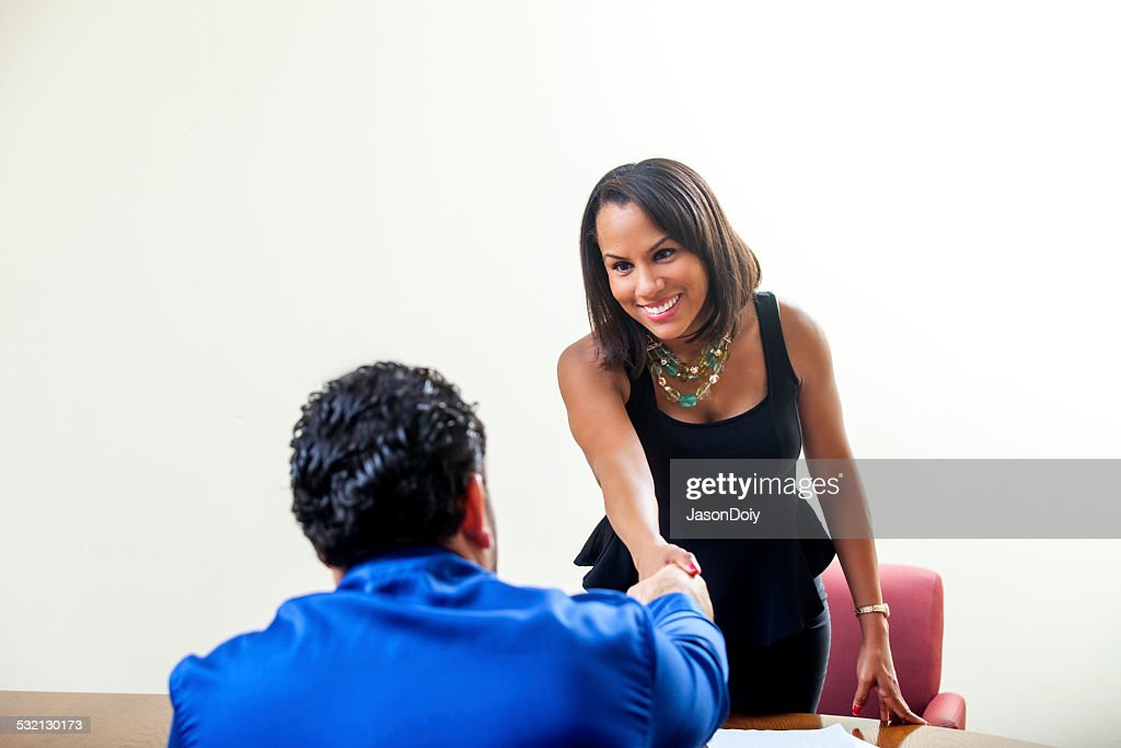 Shaking Hands: You're Hired : Stock Photo