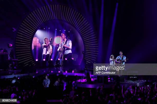 Shakira and Chris Martin from Coldplay perform together on stage during the Global Citizen Festival G20 benefit concert at the Barclaycard Arena in...