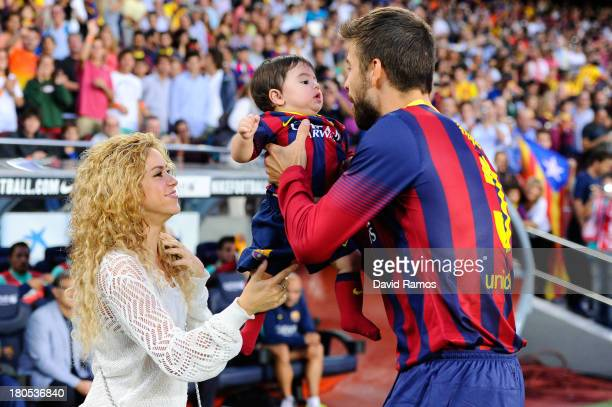 Shakira and Gerard Pique of FC Barcelona are seen with their son Milan prior to the La Liga match between FC Barcelona and Sevilla FC at Camp Nou on...
