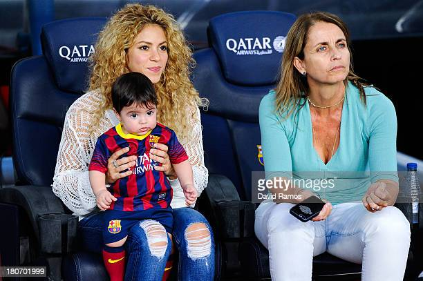 Shakira and Montserrat Bernabeu Gerard Pique's mother play with Milan prior to the La Liga match between FC Barcelona and Sevilla FC at Camp Nou on...