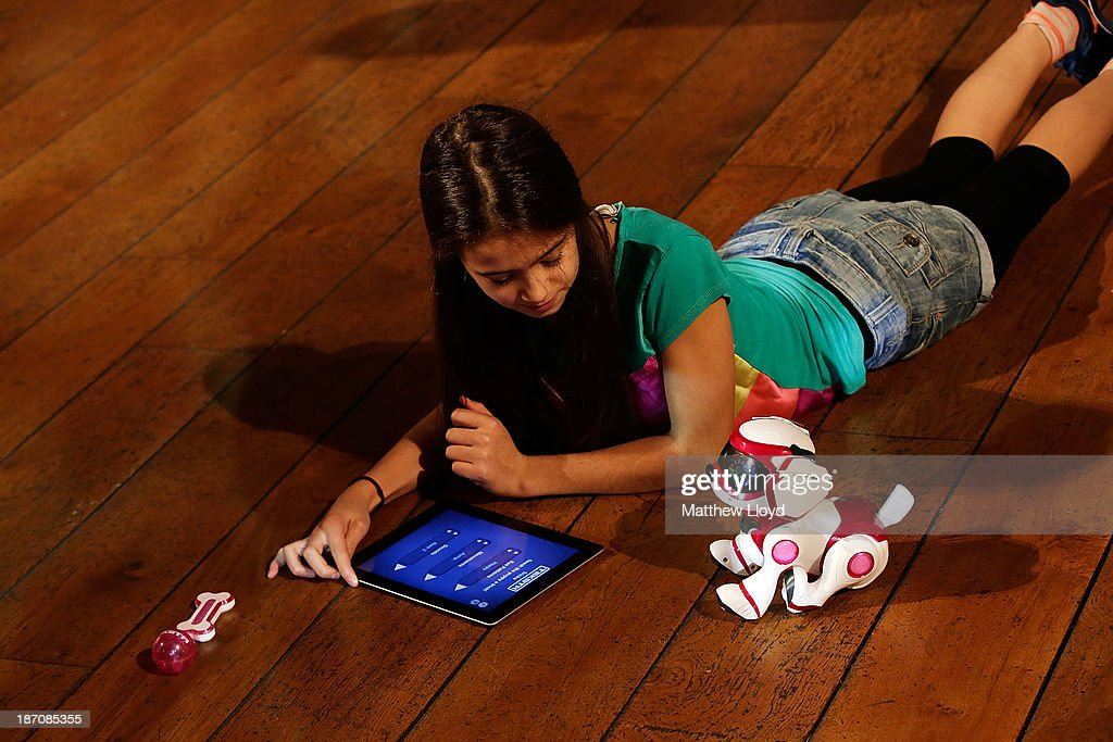Shakira Riddell-Morales (11) plays with a Teksta robotic puppy at a media event at St Mary's Church in Marylebone on November 6, 2013 in London, England. The Toy Retailers Association's Dream Toys chart, is an independent list of the predicted Christmas top 12 best-selling gifts for children.