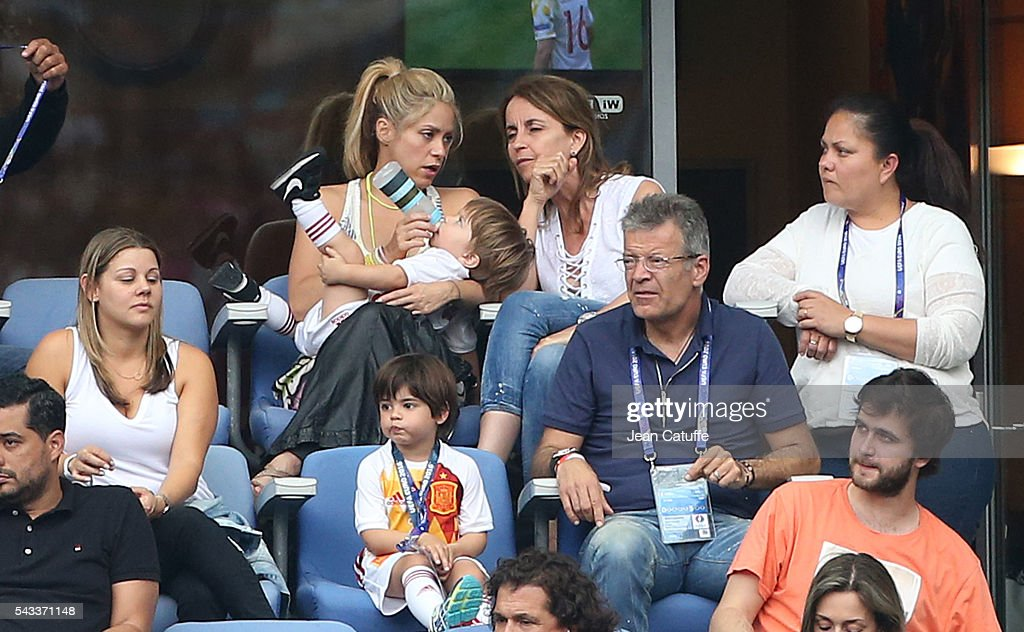 Shakira, wife of Gerard Pique and their two sons, Milan Pique Mebarak and the younger Sasha Pique Mebarak, along Pique's parents Montserrat Bernabeu and Joan Pique attend the UEFA Euro 2016 round of 16 match between Italy and Spain at Stade de France on June 27, 2016 in Paris, France.