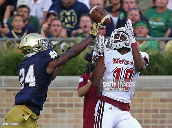 Shakur Nesmith of the Massachusetts Minutemen catches a touchdown pass over Nick Coleman of the Notre Dame Fighting Irish at Notre Dame Stadium on...