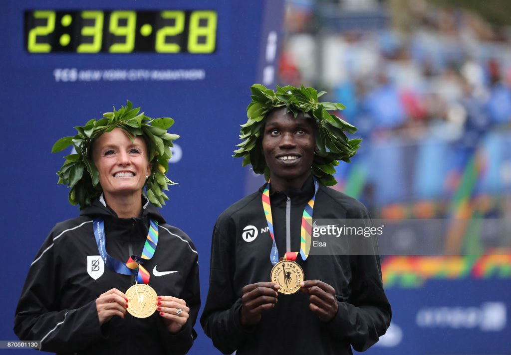Shalane Flanagan of the United States and Geoffrey Kamworor of Kenya celebrate winning the Professional Divisions of the 2017 TCS New York City Marathon in Central Park on November 5, 2017 in New York City.