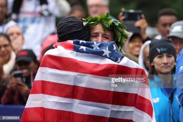 Shalane Flanagan of the United States gets a hug as she celebrates winning the Professional Women's Division during the 2017 TCS New York City...